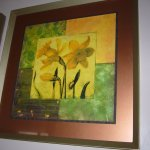 PAINTING OF FLOWERS MOUNTED ON TILES HUNG ON WALL