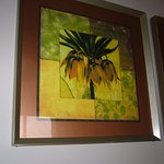 PAINTING OF PLANT WITH FLOWERS MOUNTED ON TILES HUNG ON WALL