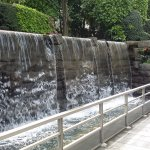 Stylish waterfall feature at side of entrance to hotel foyer