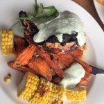 Chicken with sweet potato fries, couscous salad, corn