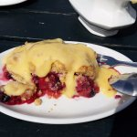 Berries crumble with tons of custard!