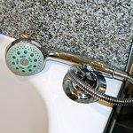 Broken hand shower retractor