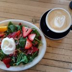 poached egg salad and cafe latte