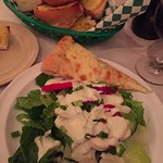 Tasty garlic bread and salad with a slice of cheese pizza