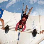 Little Elise flying a hang glider