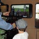 They have a locomotive simulator, volunteers help the children with their engineer skills.