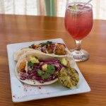 "Fish tacos topped with some tasty slaw along side our classic ""I Need a Miracle"" margarita"