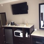 Well appointed rooms with a desk, large flat screen tv, coffee maker large mini fridge and comfo