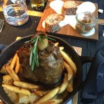 Schweinshaxe with soggy french fry looking noodles, soaked in a wine sauce.