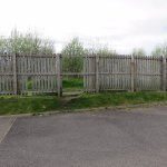Several breaches in the boundary fence allowing easy access to a public footpath