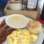 Scrambled eggs,bacon,grits and a yummy southern style biscuit.