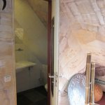 Unlike other rooms in the hotel, 304 (baobab) has a small enclosed bathroom