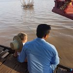 Our tuk tuk driver enjoying the view with our little one