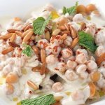 Fatteh, speciality dish made with layers of toasted bread, chickpeas, tahini and nuts