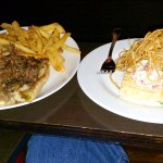 Ribeye cheese steak on left. A little lobster and a lot of potato on the right.