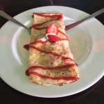 Freshly made pancakes with mouthwatering strawberries.