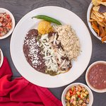 Blue Corn Enchiladas with complimentary sweet potato and tortilla chips and salsas