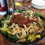 Awesome Seared Ahi Tuna with an excellent rub over an awesome Asian salad Took half the salad ho