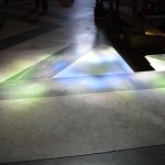 A play of light on the floor through the stained glass windows