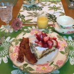 Delicious breakfast! Fresh strawberries decadent Cream Brulé French toast and perfectly cooked b
