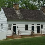 Reproduction building that depicted guest house and slave quarters.