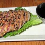 Sesame Seared Ahi Tuna Perfectly seasoned yellow fin tuna covered in sesame seeds & lightly sear