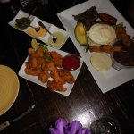 Tapas of chicken wings and crispy pork belly plus Bandeja Paisa (grilled platter)