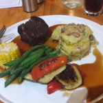 Sirloin steak cooked to perfection with fresh veggies and creamy potato