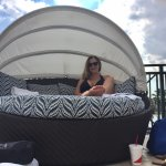 wife enjoying the pool area in the covered cabana