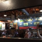 Open beam ceiling, lots of trophy fish in a wheelchair friendly dining room