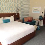 King bed and seating area in room 324