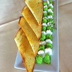 Tasty green pea and ricotta spreads with toast.