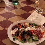 Tasty salad from salad bar with glass of wine