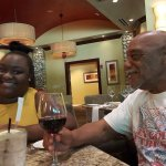 hubby celebrating turning 70 with glass of wine
