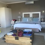 Our room, large beautiful, ocean colored pillows, white linens, ocean themed space