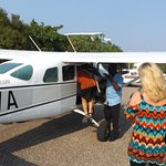 Boarding our plane at Caye Caulker airport.