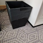 5-star hotel with trashcans held together with tape.