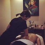 Mai performing Deep Tissue Massage.