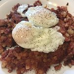 poached eggs and corn-beef hash