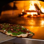 The Spinach and Craisan Flatbread is one of the many items we cook in our wood fired oven