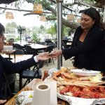 Our server, Ana, shows my friend how to shuck an oyster.