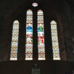 Stained glass windows in back of church