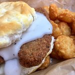 Old Rock's Fried Steak and Peppered Gravy Biscuit with tater tots.