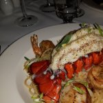 Canadian lobster tail with shrimp, sea scallops and wine-cooked pasta and chardonnay lemon sauce