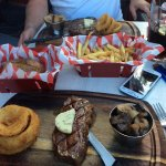 Sirloin with garlic butter, onion rings, mushrooms and baked potato! Delicious!