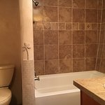 Private bathrooms in every room feature a deep soaking tub/shower combination.