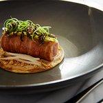 Roasted quail roll, pancetta, savoury pancake, bang bang puree, chilli cashew, wood ear funghi