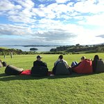 On the lawn of the Vineyard restaurant, guests enjoy the view looking back toward Auckland.
