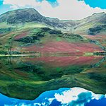 The pines and heather-clad hills with several tributaries feeding the lake