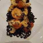 TAGLIOLINI PORTOFINO homemade black tagliolini with butterfy prawns, garlic & tomato sauce